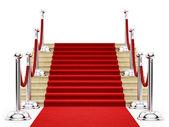 серебряный стоек и красный ковер — Стоковое фото