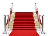 Silver stanchions and a red carpet — ストック写真