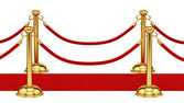 Gold stanchions and a red carpet — Stock Photo