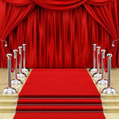 Silver stanchions and a red carpet — 图库照片