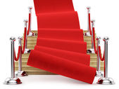 Red carpet on stairs — Stock Photo