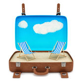 Suitcase with 2 deckchairs — Stock Photo