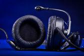 Headphones on the blue background — Stock Photo