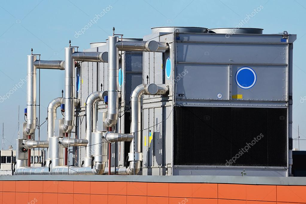 This photograph represents an industrial air conditioning unit cooling system on the roof of a building — Stock Photo #14697269