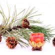 Pine branch with cone and candle — Stock Photo