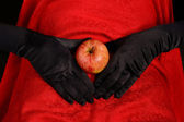 Apple on abdomen — Stock Photo