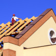 Man working on the new roof — Stock Photo