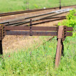 Rusty buffer stop at the end of a railroad track — Stock Photo #26083819