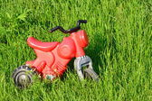 Little red motorcycle plastic — Stock Photo