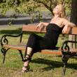 Beautiful blond woman sunbathing in the park — Stock Photo