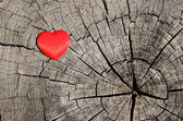Red heart on a wooden background — Photo