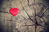 Vintage photo of red heart on a wooden background — Stock fotografie