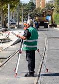 Land surveyor in work in construction — Stock Photo