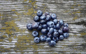 Fresh blueberries on wooden background — Stock Photo
