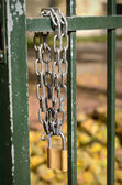 Padlock in the fence — Stock Photo