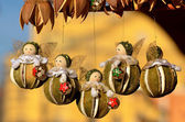 Hanging wooden angels — Foto de Stock