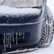 Tires on road are covered with snow — Stock Photo #40267071