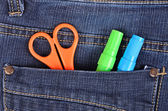 Scissors and pen in the blue jeans pocket — Stock Photo