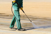 Wet cleaning of city streets — Stock Photo