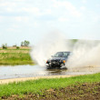 Rally race in Kunmadaras, Hungary April 27. BMW driving over the large puddle. — Stock Photo #45803633