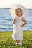 Young beautiful girl posing for the camera in white dress — Stock Photo
