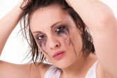 Crying young woman with flowed mascara — Stock Photo