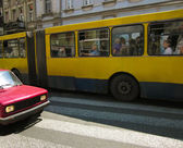 Big double yelow bus in the city traffic — Foto de Stock