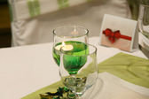 Glasses and plates on table — Стоковое фото