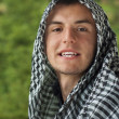 Young muslim man with scarf on head outdoor — Stock Photo #31828449