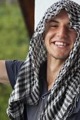 Young muslim man with scarf on head outdoor — Photo