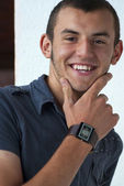 Handsome young man with modern watch posing — Stockfoto