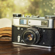 Vintage camera and old book — Stock Photo
