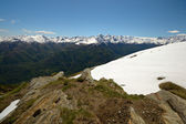 Snowcapped alpine arc in spring — Stock Photo