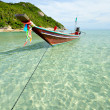 Boat floating on transparent water — Stock Photo #40259191