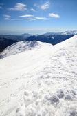 Panoramic snowy ridge — Stock Photo