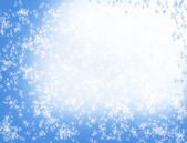 Light blue Christmas background with white abstract snowflakes — Stock Photo