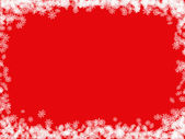 Red Christmas background with white abstract snowflakes — Stock Photo