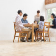 Japanese family gather at dining table - Stock Photo