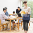 Japanese family enjoying lunch together - Stock fotografie