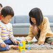 Royalty-Free Stock Photo: Japanese father and his children building blocks