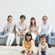 Japanese family gather at living room - Stockfoto