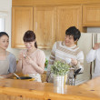 Japanese family in a kitchen - Stock Photo
