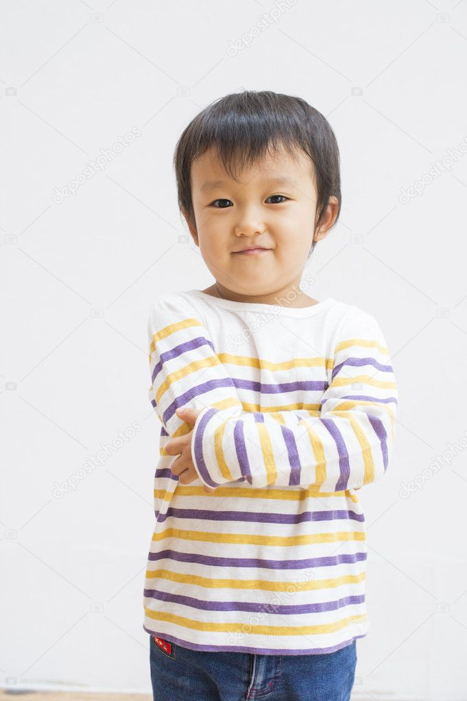 Japanese boy standing against white wall — Stock Photo #14968657