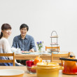 Japanese husband and wife at dining table - Foto Stock