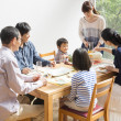 Japanese family gather at dining table - Стоковая фотография