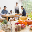 Japanese family gather at dining table - Foto Stock