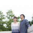 Japanese couple at a deck in woodland - 图库照片