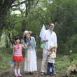 Japanese children and their grandparents in woods - Stock Photo