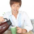 Japanese man preparing coffee before he goes to work - Stock Photo