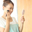 Japanese woman doing makeup - Stock Photo